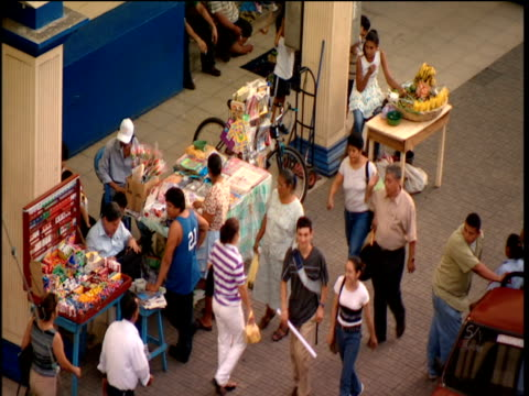 shoppers walk through market nicaragua - nicaragua video stock e b–roll