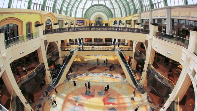 ha shoppers walking around the mall of the emirates / dubai, united arab emirates - shopping centre stock videos & royalty-free footage