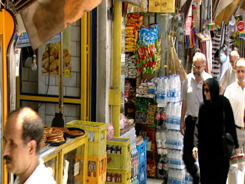 vídeos y material grabado en eventos de stock de shoppers walking around the market on a sunny day / tehran, iran - formato buzón