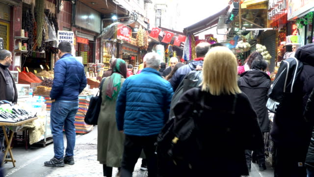 shoppers walking through the shopping street next to egyptian spice market in istanbul. crowds of people - spice bazaar stock videos & royalty-free footage