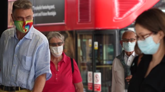 slomo shoppers wear face masks as they enter a store on july 24 2020 in london england from today it is compulsory for shoppers to wear face masks... - building feature stock videos & royalty-free footage