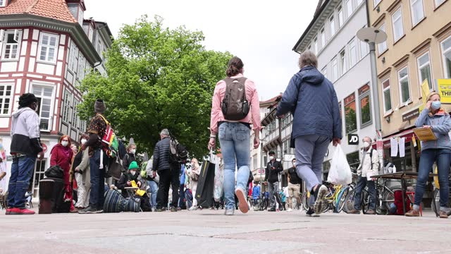 shoppers wearing protective face masks crowd shopping street in the city center during the third wave of the coronavirus pandemic on may 29, 2021 in... - pedestrian zone stock videos & royalty-free footage