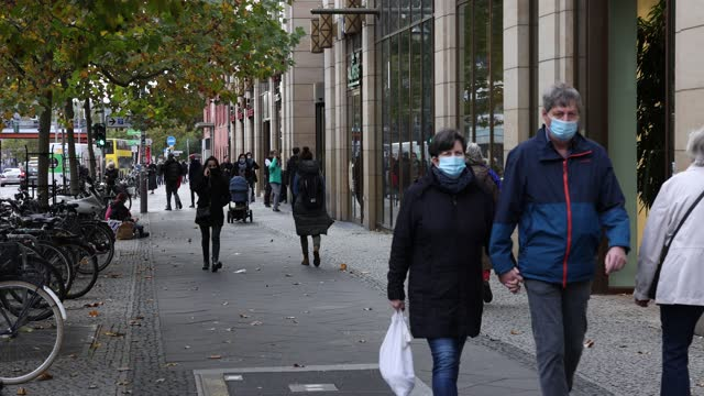shoppers wearing protective face masks walk on the main shopping street called schlossstrasse on which there is a protective face mask obligation in... - street name sign stock videos & royalty-free footage