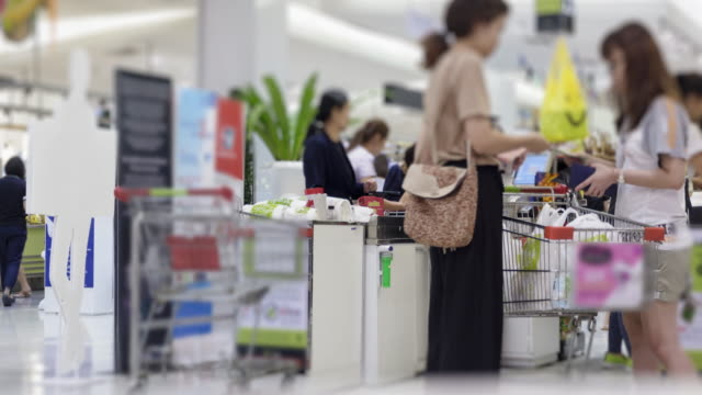 SEA: Shopping : 4K timelapse Customers shopping for goods at the check counter supermarket.