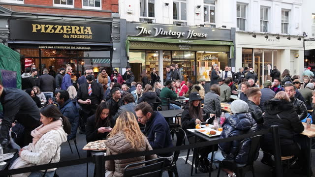 shopping and outdoor dining in london as covid-19 restrictions were lifted in london, england, uk, on monday, april 12, 2021. - pedestrian crossing stock videos & royalty-free footage