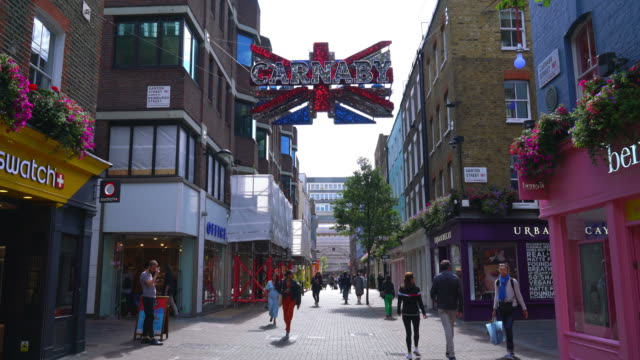 shopping area at carnaby street in london - window display stock videos & royalty-free footage