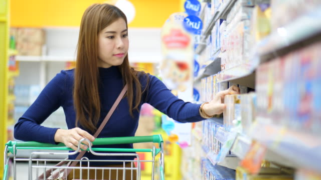 shopping at grocery store - market retail space stock videos & royalty-free footage
