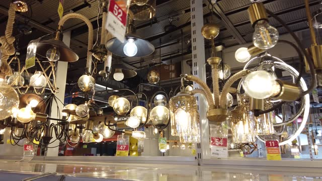 shopping at home decoration market - electric lamp stock videos & royalty-free footage