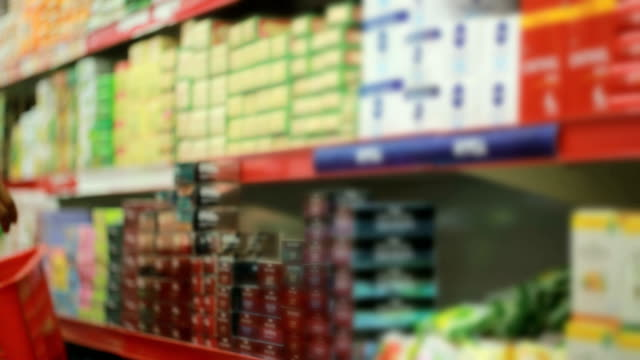 shopping at super market - shopping basket stock videos and b-roll footage