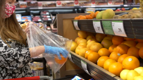 shopping at the grocery store - obscured face stock videos & royalty-free footage