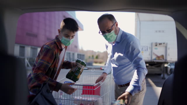 shopping at the moment of covid-19 - pollution mask stock videos & royalty-free footage