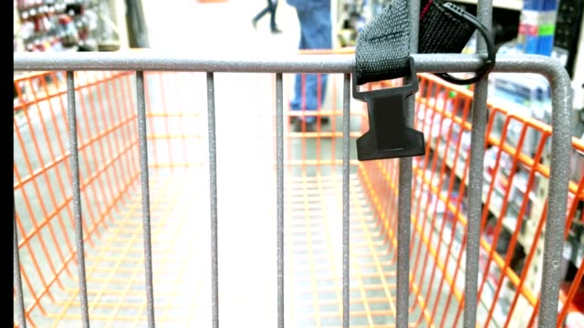 shopping cart in aisle of store. - market retail space stock videos & royalty-free footage