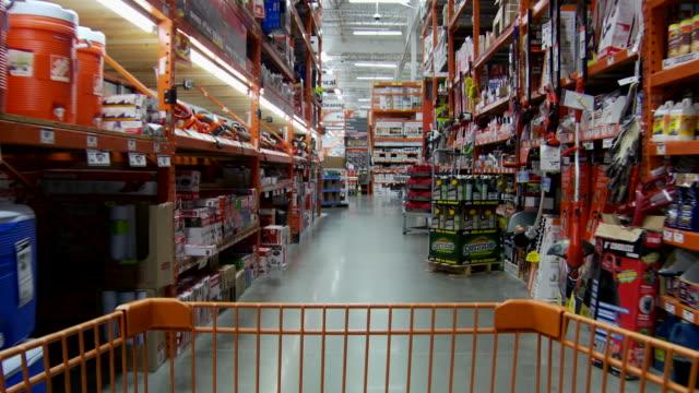ms pov shopping cart moving through aisles of retail store / atlanta, georgia, usa - handwagen stock-videos und b-roll-filmmaterial
