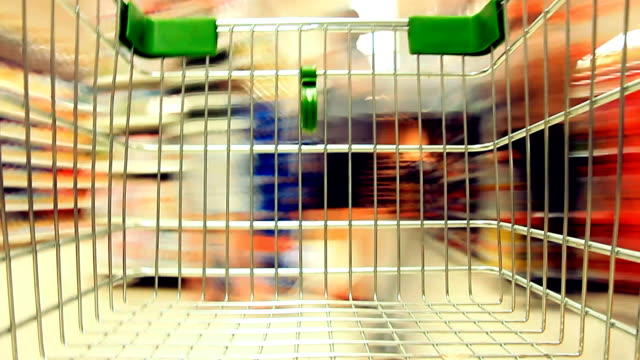 shopping cart view of grocery time lapse. - trolley stock videos and b-roll footage