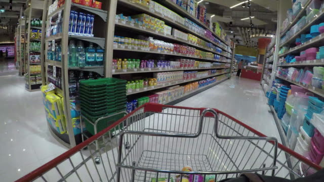shopping cart view of grocery time lapse. - shopping trolley stock videos and b-roll footage