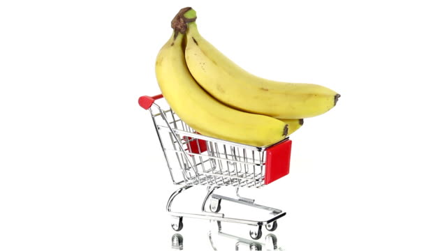 shopping cart with tropical and citrus fruits spinning - cart stock videos and b-roll footage