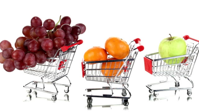 shopping carts with tropical and citrus fruits rolling one after another - kiwi fruit stock videos and b-roll footage