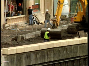 stockvideo's en b-roll-footage met shopping centre under construction by a canal, reading, uk; 1999 - shopping centre