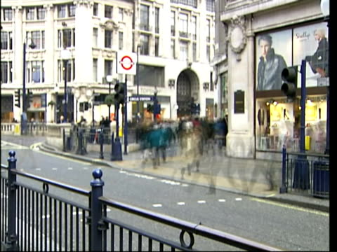 shopping days till christmas england: london: oxford street: ext i/c as along with christmas shoppers bv feet of shoppers along shoppers reflected in... - christmas decoration stock videos & royalty-free footage