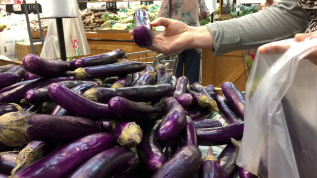 shopping eggplant at grocery - aubergine stock videos & royalty-free footage