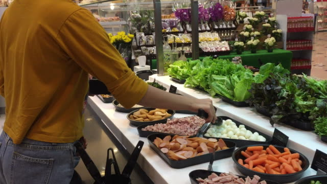 shopping food at salad bar in supermarket - food bar stock videos and b-roll footage