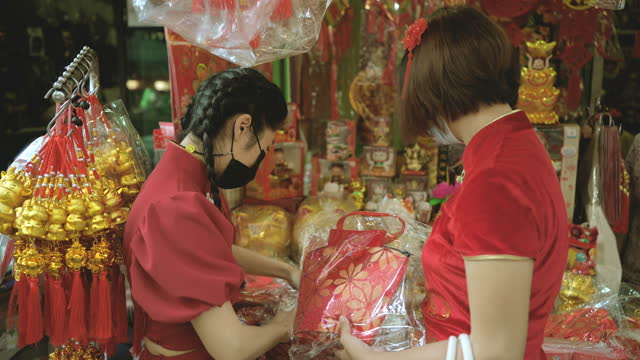shopping for chinese new year - chinese culture stock videos & royalty-free footage