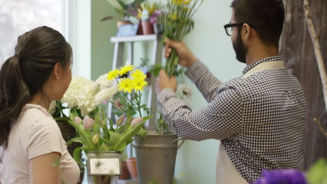 shopping for flowers - retail occupation stock videos & royalty-free footage