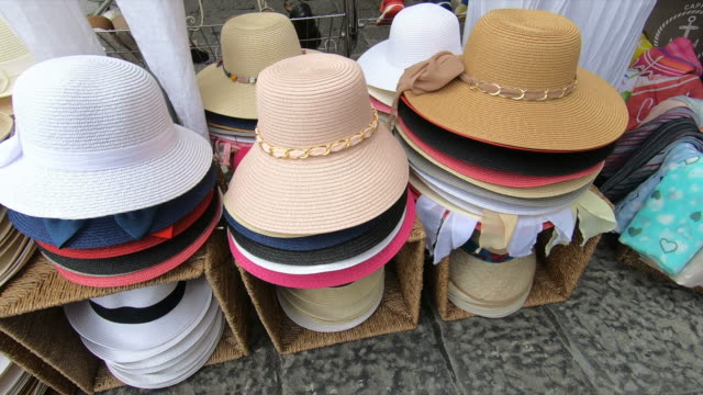 stockvideo's en b-roll-footage met shopping for hats in capri island, italy, europe, mediterranean sea. - slow motion - hoed