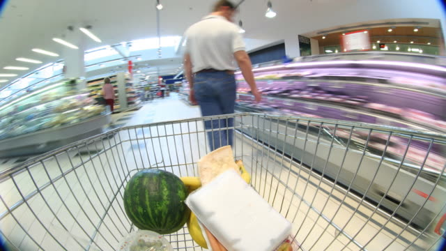 shopping frenzy: time lapse madness at the supermarket - cart stock videos & royalty-free footage