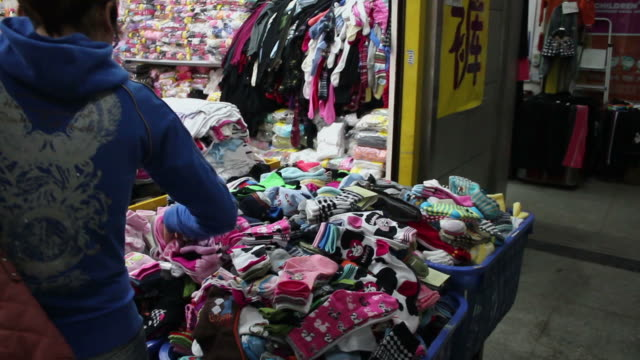 ws pov shopping girl in market/xian,shaanxi,china - one mid adult woman only stock videos & royalty-free footage