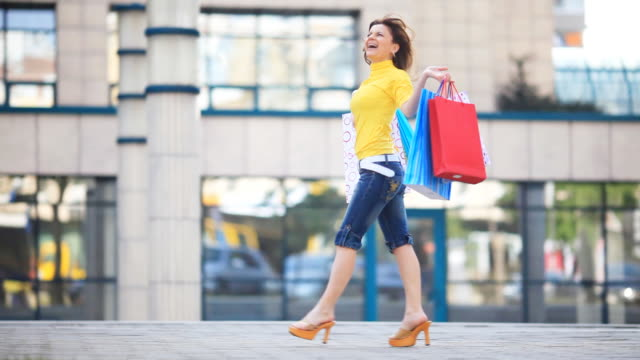 shopping happy girl. - shopping bag stock videos & royalty-free footage