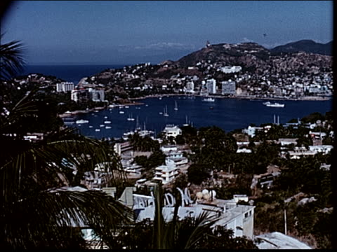 stockvideo's en b-roll-footage met 1963 shopping in acapulco - 1963
