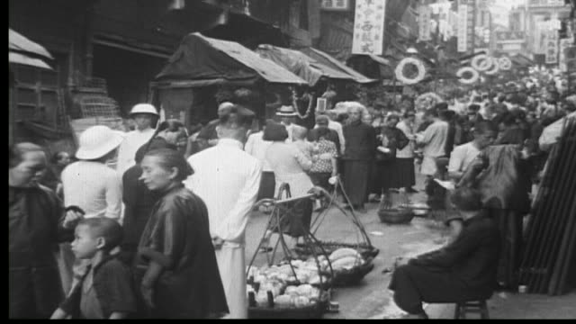 1938 shopping in hong kong - retail occupation stock videos & royalty-free footage