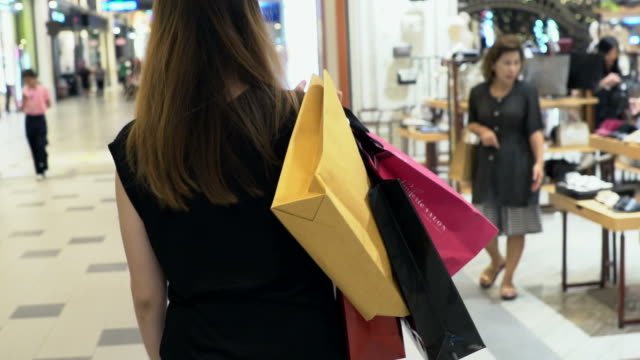 shopping in slow motion. - shopping bag stock videos & royalty-free footage