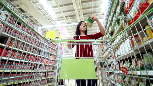 shopping in supermaket - shopping trolley stock videos and b-roll footage