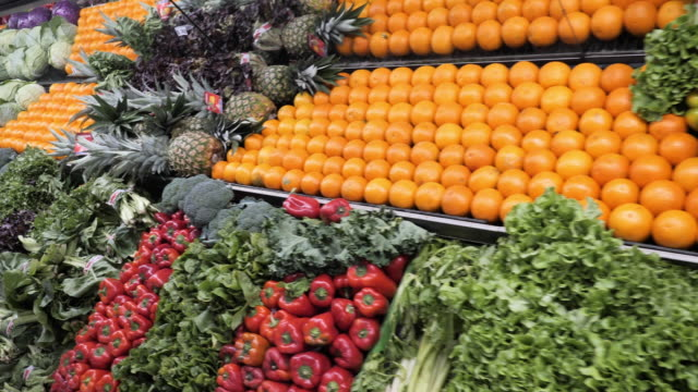 shopping in supermarket - fruit and vegetables department - market stall stock videos & royalty-free footage