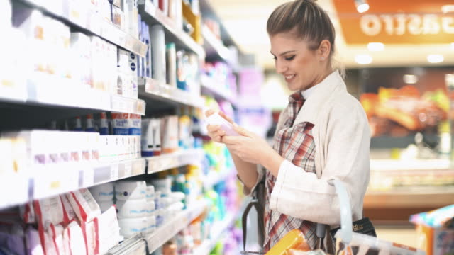 shopping in supermarket - shampoo stock videos & royalty-free footage