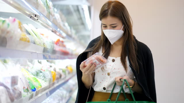 shopping in supermarket with face mask - variation video stock e b–roll