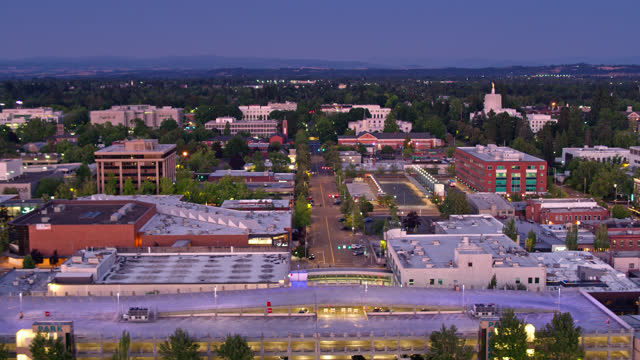 shopping mall on the edge of downtown salem at dusk - aerial - oregon us state stock videos & royalty-free footage