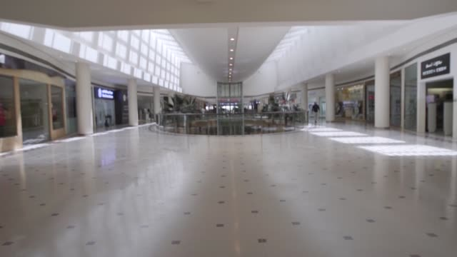 shopping mall stands in riyadh, saudi arabia on june 8, 2015. shots of: wide shot of the interiors of a shopping mall, wide shot of a few shoppers... - riyadh stock videos & royalty-free footage