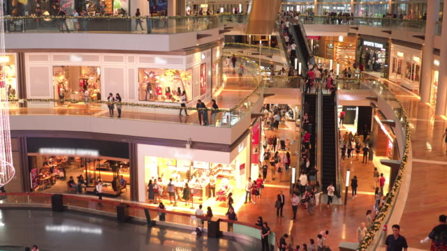 shopping mall with escalator terrace in weekend - singapore stock videos & royalty-free footage