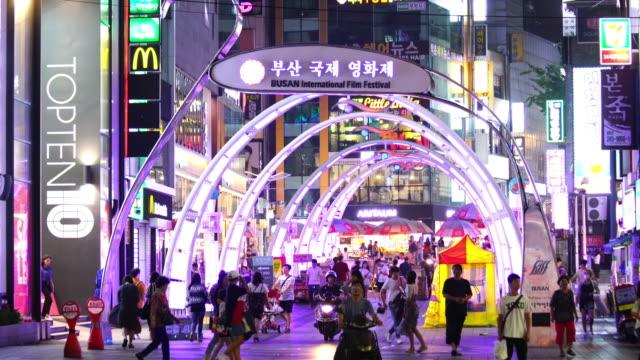 shopping street at night in busan, south korea - korea stock videos & royalty-free footage