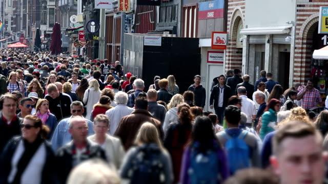 shopping street in amsterdam (damrak) - pedestrian zone stock videos & royalty-free footage