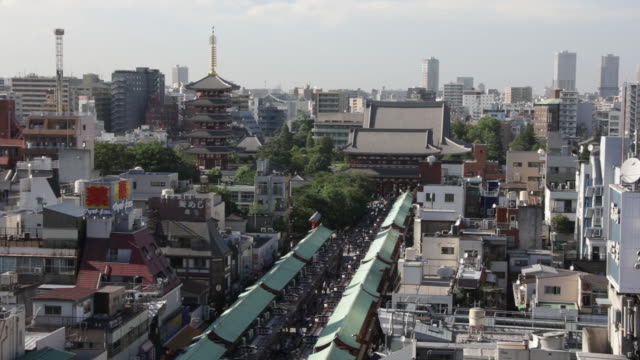shopping street leading to the temple in the asakusa district in tokyo japan on monday july 2 2018 - shitamachi stock videos and b-roll footage