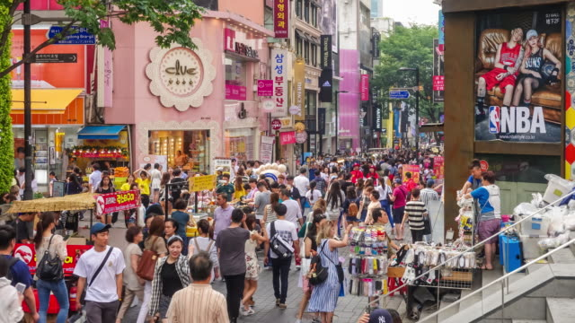 shopping street myeongdong in seoul - korea stock-videos und b-roll-filmmaterial