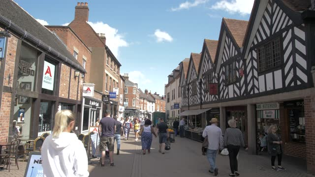 shopping street on sunny day in summer, lichfield, staffordshire, england, united kingdom, europe - staffordshire england stock videos & royalty-free footage