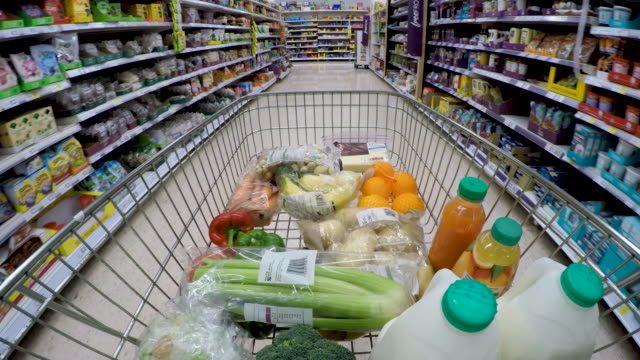 shopping trolley pov moving down supermarket aisle. - choosing stock videos & royalty-free footage
