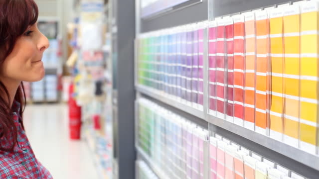 shopping wall color in the hardware store - diy stock videos & royalty-free footage