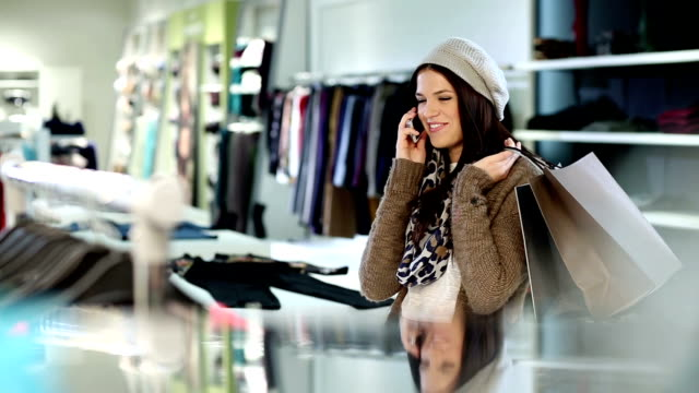 Shopping woman using mobile phone