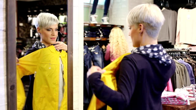 Shopping woman with yellow jacket